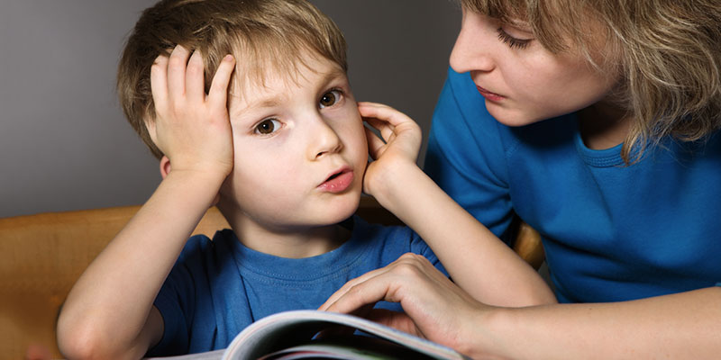 Mother talking to her son over homework